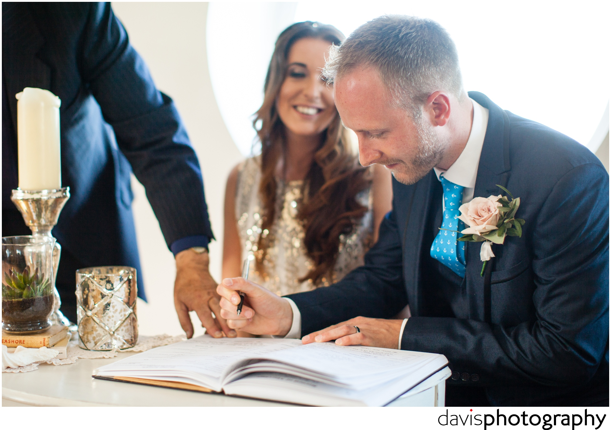 groom signs the marriage register