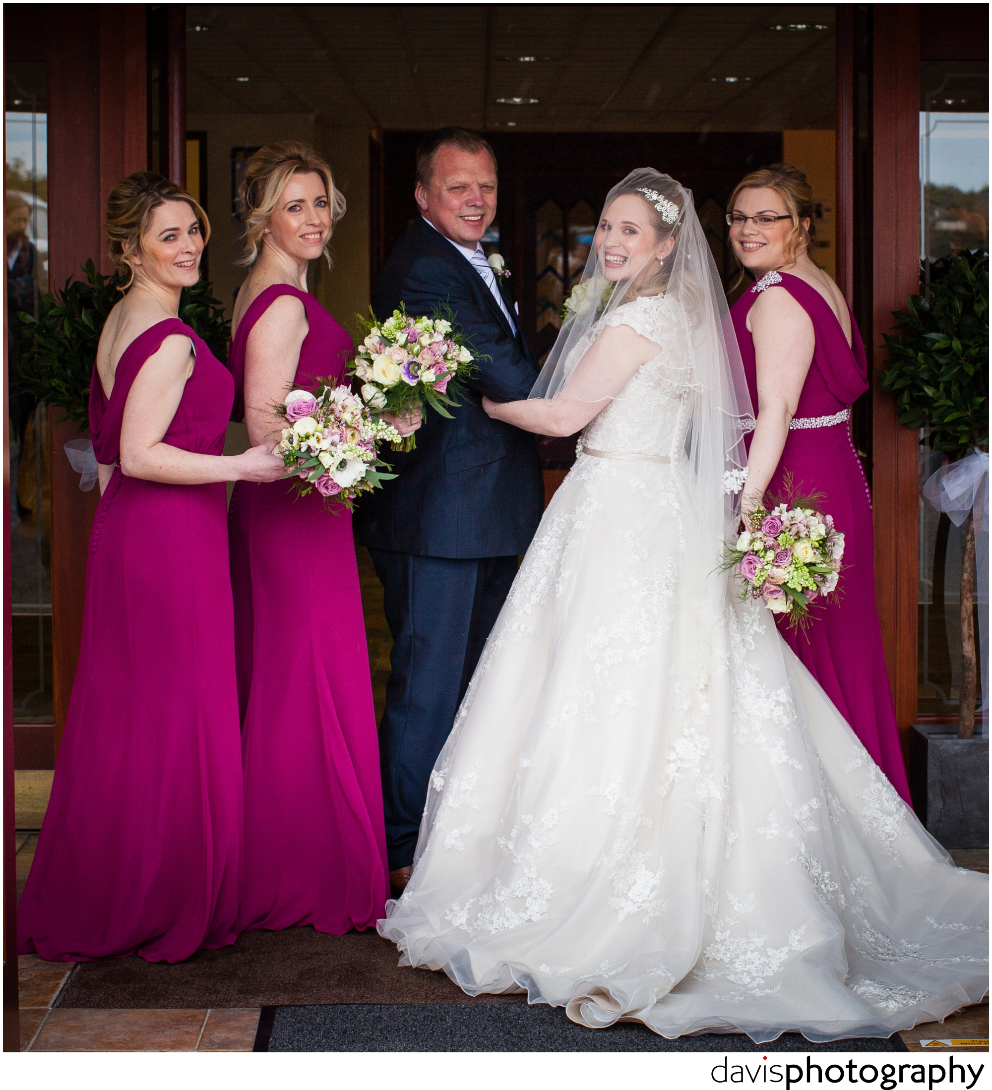 bride enters church with bridesmaids