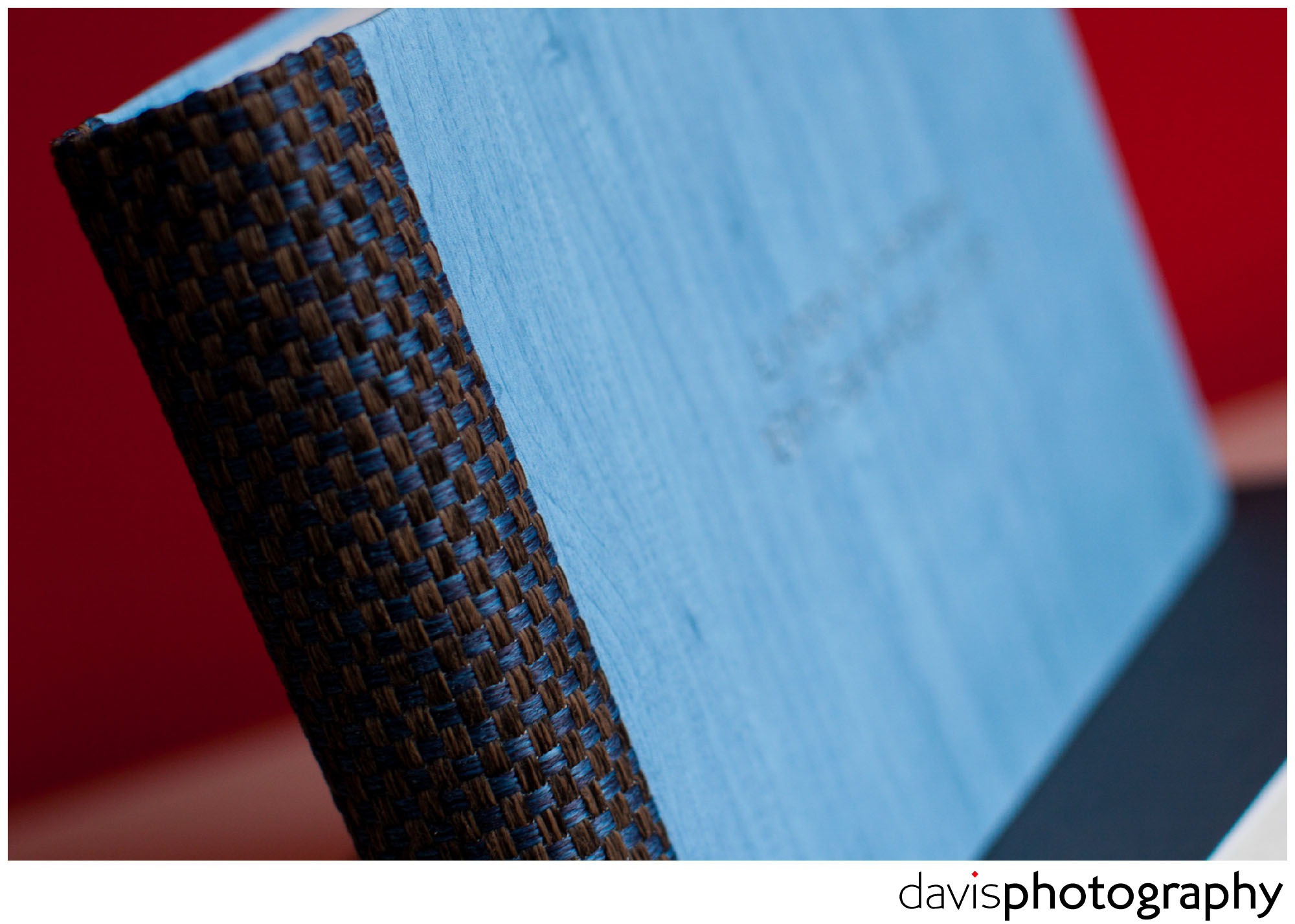 Powder blue maple covered matted album with brown and matching blue woven spine detail gives textures that you want to touch.